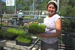 LINPI director Polly Weigand with native grasses planted by her group's volunteers