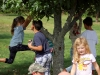 Peconic Community School students try out some new tree-climbing moves after the performance.